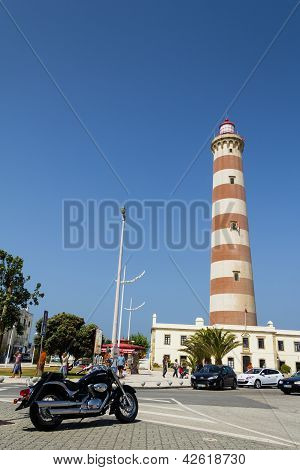 View of Aveiro lighthouse and black bike in summer