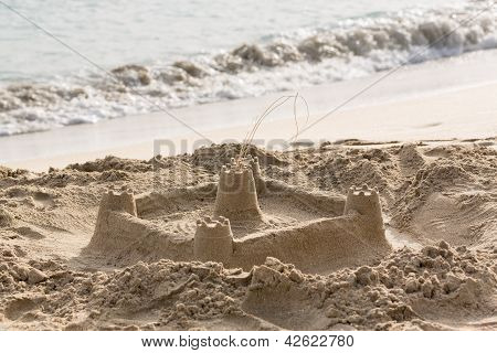 Childs Sand Castle On Beach By Ocean