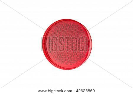 Red round reflector isolated on white