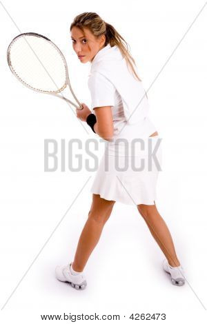 Back Pose Of Woman Holding Racket
