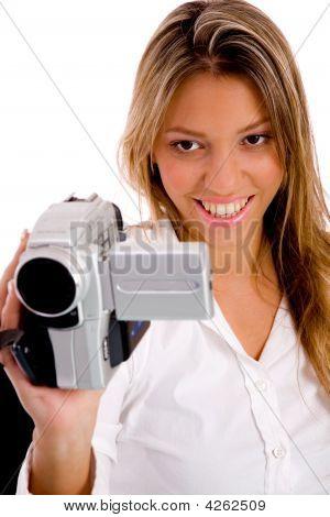 Portrait Of Smiling Woman Recording Through Handy Cam