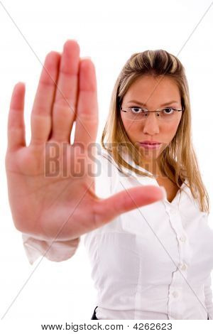 Front View Of Businesswoman Showing Stopping Gesture