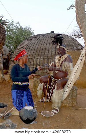 Zulu Chief with his wife in Shakaland Zulu Village, South africa