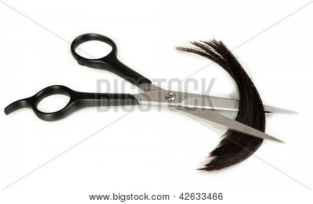 Pieces of hair cut with scissors isolated on white