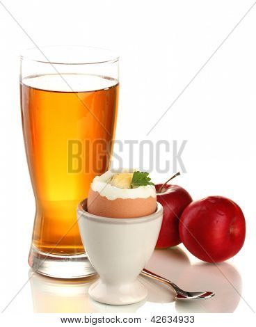 Light breakfast with boiled egg and glass of juice, isolated on white