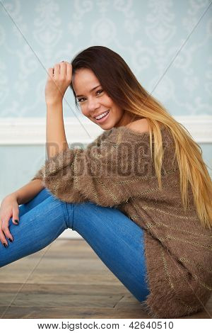 Portrait Of A Beautiful Woman Sitting On Floor