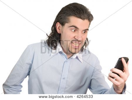 Young Handsome Male Screams In Anger On His Cell Phone Isolated
