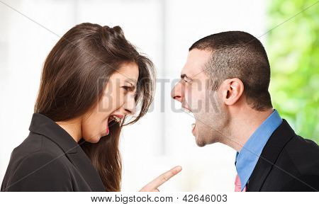 Two persons yelling out to each other