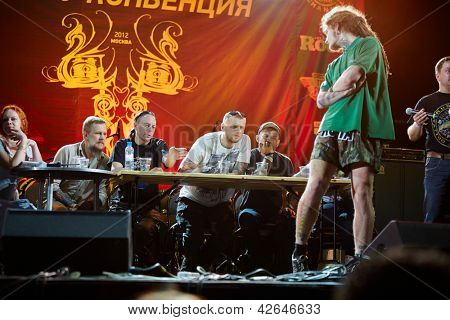 MOSCOW - MAY 20: Jury assesses tattoo at club ARENA-MOSCOW during V Moscow International Tattoo Convention 2012, May 20, 2012, Moscow, Russia. Convention was organized by Tattoo Studio Angel.