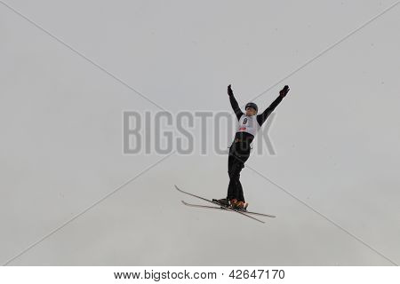 BUKOVEL, UKRAINE - FEBRUARY 23: Maxim Gustik, Belarus performs aerial skiing during Freestyle Ski World Cup in Bukovel, Ukraine on February 23, 2013.