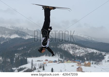 BUKOVEL, UKRAINE - FEBRUARY 23: Oleksandr Abramenko, Ukraine performs aerial skiing during Freestyle Ski World Cup in Bukovel, Ukraine on February 23, 2013.
