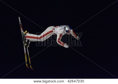 BUKOVEL, UKRAINE - FEBRUARY 23: Travis Gerrits, Switzerland performs aerial skiing during Freestyle Ski World Cup in Bukovel, Ukraine on February 23, 2013.