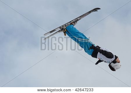 BUKOVEL, UKRAINE - FEBRUARY 23: Zhibek Arapbayeva, Kazakhstan performs aerial skiing during Freestyle Ski World Cup in Bukovel, Ukraine on February 23, 2013.