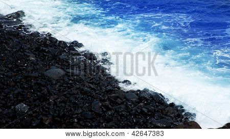 Atlantic volcanic black coast in la Palma with foam in funecaliente Canary Islands