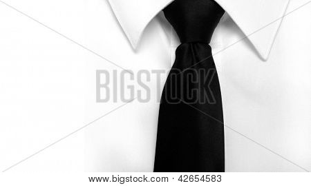 Closeup of white shirt and black tie with copy space