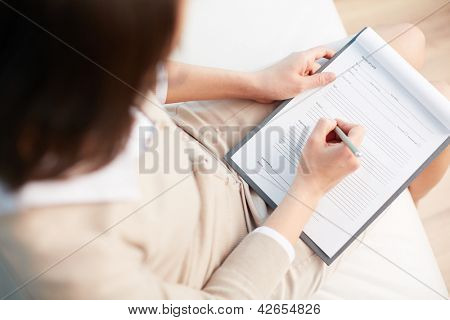 Female counselor writing down some information about her patient