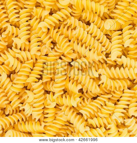 Italian Fusilli, Rotini Or Scroodle Macaroni Pasta Food Background Texture