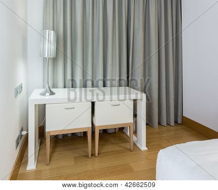 Modern White Table And Chairs In Bedroom