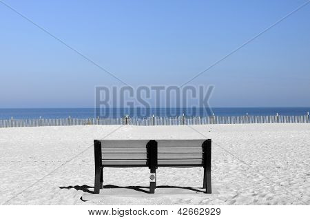 Solitary Bench on Beach