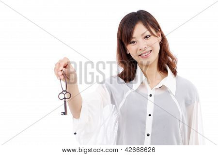 Young asian woman holding a key