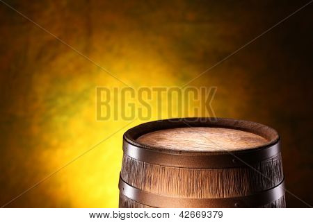 Wooden barrel on a dark yellow background.