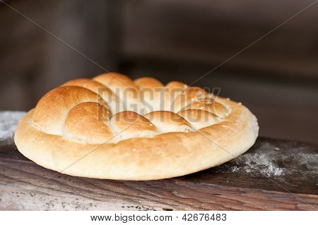 Pretzel on wooden background. Rustic scene