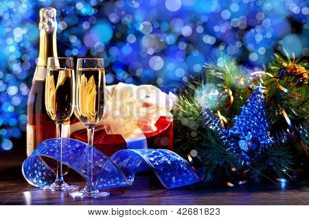 New Year's collage with glasses of champagne. Decorations and ribbons on a bright color background