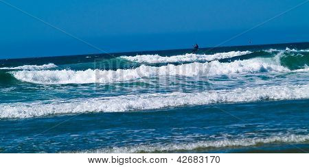 Kite Surfer Out On The Ocean On A Sunny Day