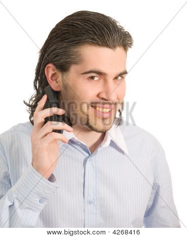 Young Handsome Man Talks On Mobile Phone Isolated White