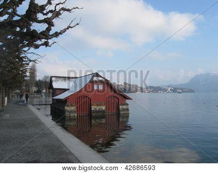 Wooden wintery boathouse