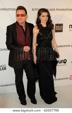 LOS ANGELES - FEB 24:  Bono, Eve Hewson arrive at the Elton John Aids Foundation 21st Academy Awards Viewing Party at the West Hollywood Park on February 24, 2013 in West Hollywood, CA