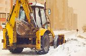 foto of plowing  - yellow snow plow on an empty street - JPG