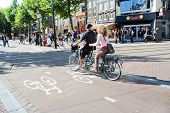 Couple Riding Tandem Bike In Amsterdam