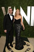 WEST HOLLYWOOD, CA - FEB 24: Jennifer Westfeldt, Jon Hamm at the Vanity Fair Oscar Party at Sunset T