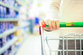 stock photo of grocery cart  - Woman shopping at the supermarket - JPG