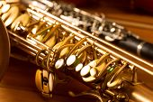 pic of sax  - Classic music Sax tenor saxophone  and clarinet in vintage wood background - JPG