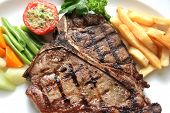 foto of t-bone steak  - photograph of big delicious t-bone steak with French fries