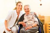 stock photo of nurse  - Young nurse and female senior in nursing home - JPG