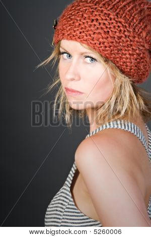 Shot Of A Pretty Blonde Girl In An Orange Beanie Hat