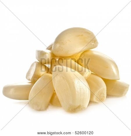 Garlic cloves heap macro close up isolated on the white background