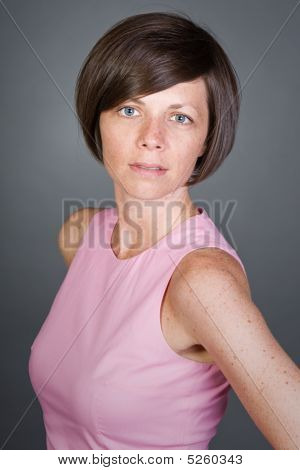 Shot Of A Pretty Brunette Lady In Pink Dress