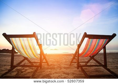 Beach chairs on the evening sea coast.