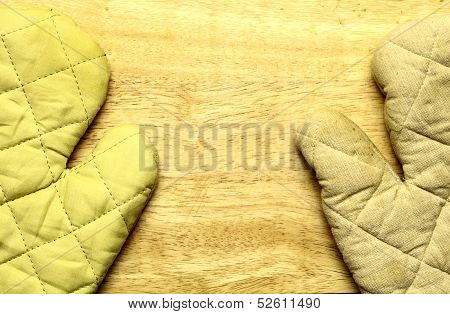 Old Wooden Kitchen Board With Protective Oven Glove