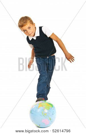 Boy Standing With Legs On World Globe