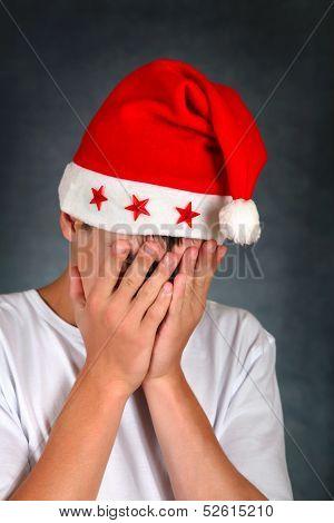 Sad Teenager In Santas Hat