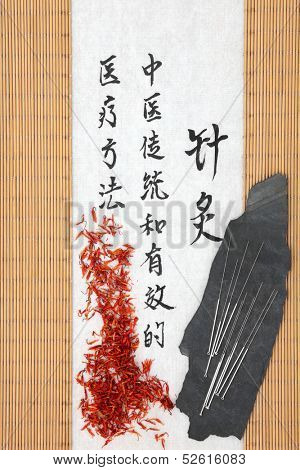 Acupuncture needles with safflower and mandarin script on rice paper over bamboo. Hong hua. Translation describes acupuncture chinese medicine as a traditional and effective medical solution.