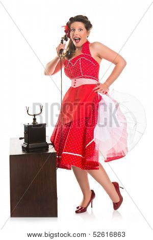 Happy pin-up girl talking on the phone