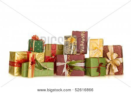 Colorful group of christmas presents decorated with ribbons and feathers