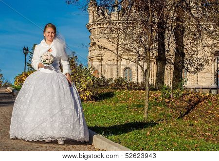 Happy bride in white dress like a princess.