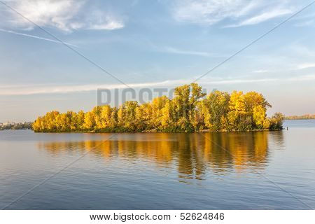 Autumn Island And Its Reflection In Blue Water